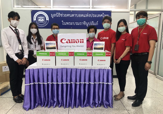 Canon contributes to the environmental protection  By donating old calendars to make a braille book for the Blind
